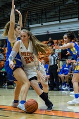Ventura College's 34-year-old forward Robin Prince, shown driving to the basket against Hancock on Feb. 13, is a petty officer in the Navy during the day.
