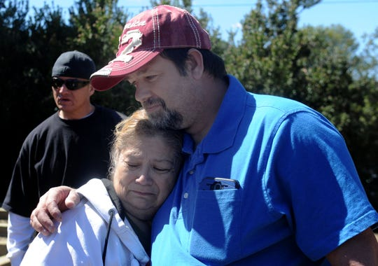 Rosemary Valdivia hugs Shiloh Pruitt, the brother of Gerald Munyon, during a memorial service for Munyon on Wednesday at the Simi Valley Samaritan Center. Munyon, who was homeless, was run over while sleeping in an alley in February.