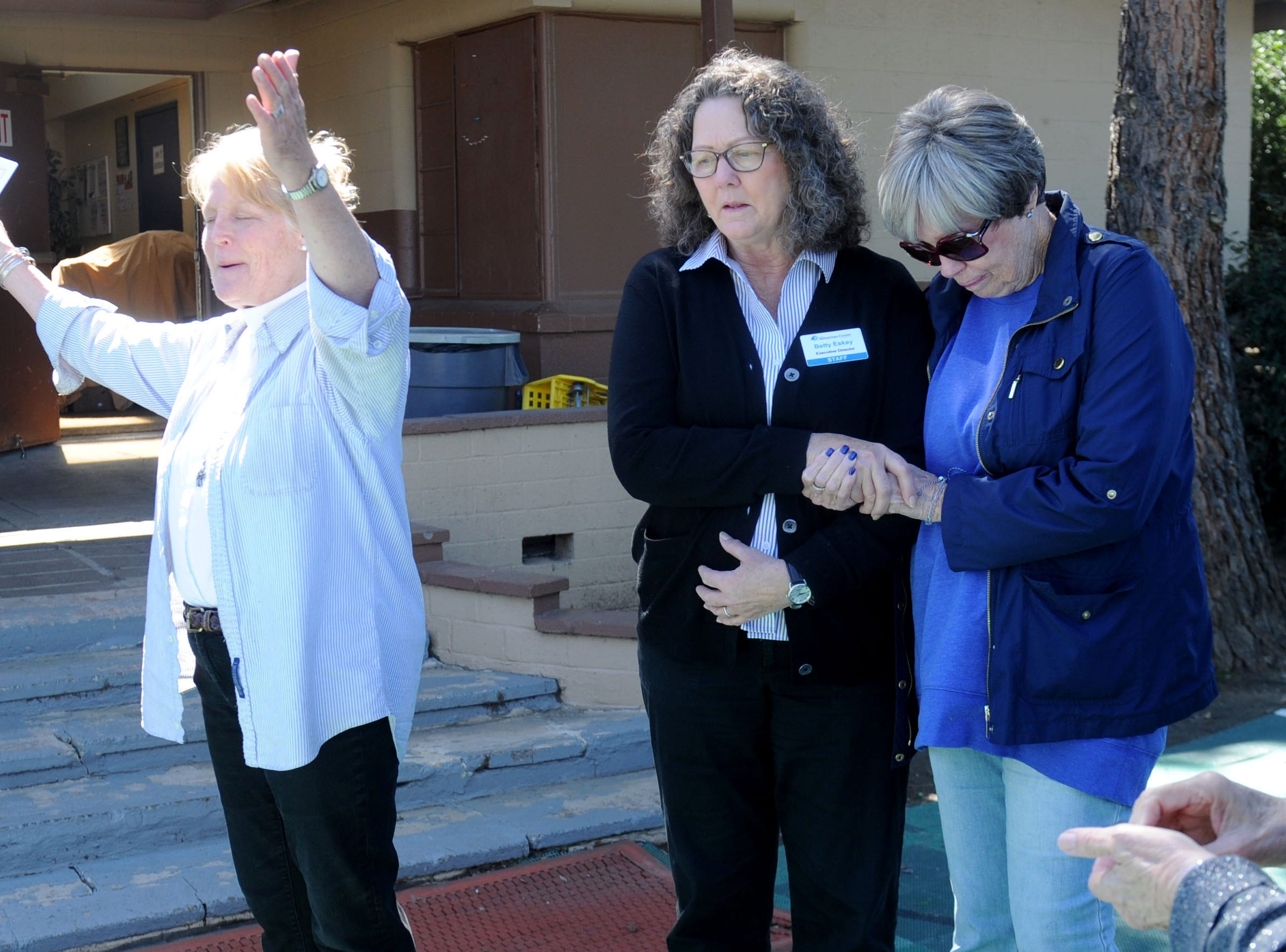 Celebrating the life of Gerald Munyon are, from left, the Rev. Sarah Kitch of St. Francis of Assisi Episcopal Church; Betty Eskey, executive director of the Samaritan Center of Simi Valley; and volunteer April Budak. The center held a memorial service Wednesday for Munyon, who was killed by a car while sleeping in an alley in February.