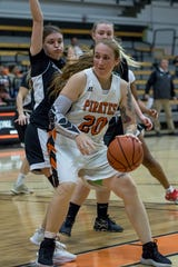 Freshman forward Robin Prince, shown dribbling against Cuesta earlier this year, has overcome nerve damage in her right arm to contribute to the Ventura College women's basketball team this season.