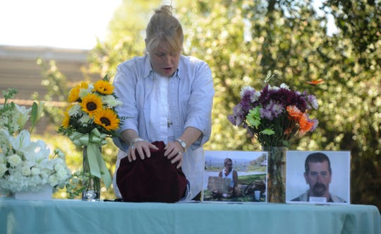 The Rev. Sarah Kitch, of St. Francis of Assisi Episcopal Church, blesses the urn of Gerald Munyon on Wednesday at the Simi Valley Samaritan Center. Munyon, who was homeless, was run over and killed while sleeping in an alley in February.