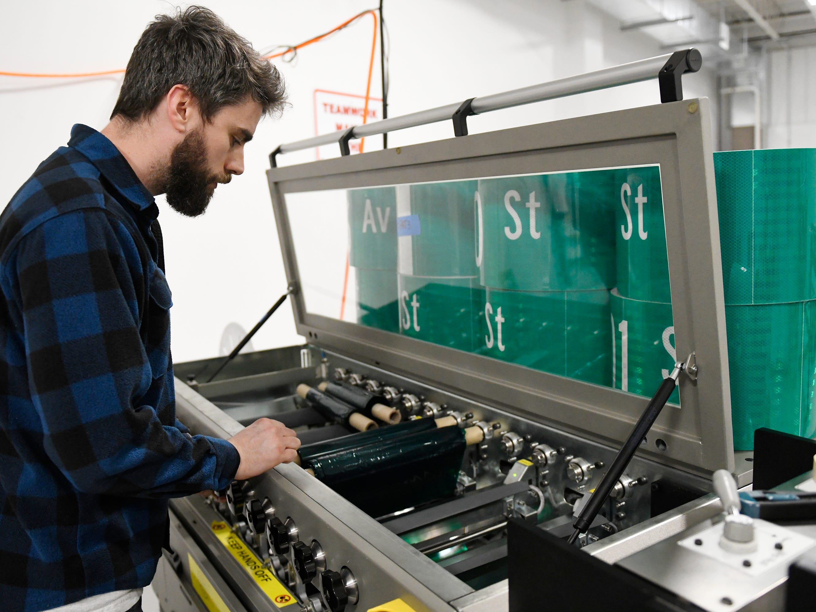 A Garden State Highway Products, Inc. employee checks one of the production machines on Tuesday, Mar. 12, 2019.