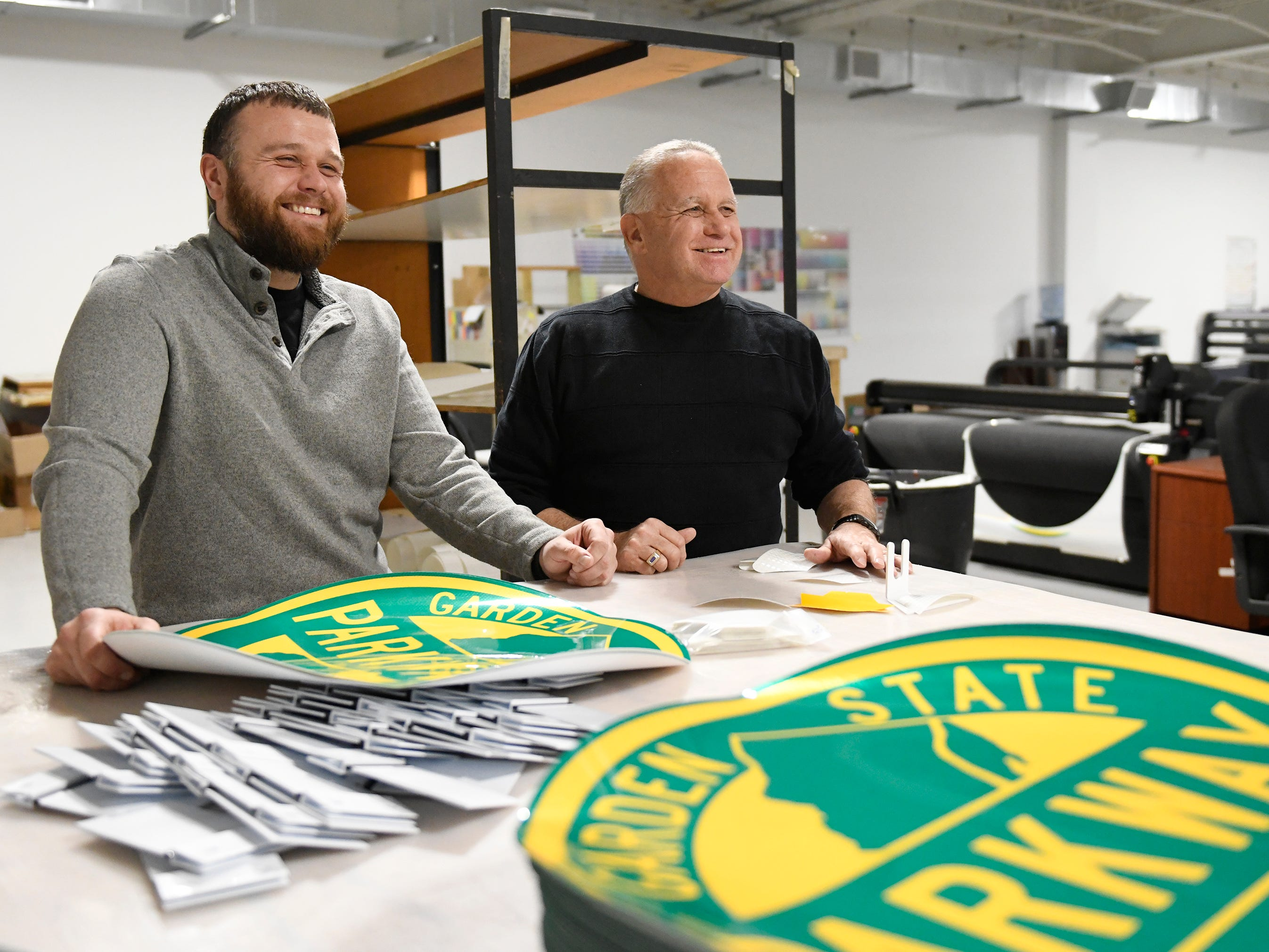 Robert Green, operations manager at Garden State Highway Products Inc., left, stands next to his father Bob who started the company with his wife Sharon in 1987.