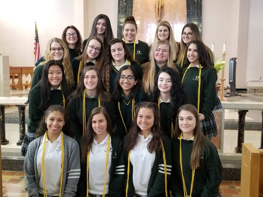 The newly inducted members of Our Lady of Mercy Academy's The Mother Patricia Gaynor Chapter of the National Honor Society are: (bottom row, from left) Tianna Berkley, Madisson Luciano, Alyssa D'Alessandro and Lia D'Orio; (second row) Kimberly Kinkade, Maris Horner, Catherine Thomas and Rachel Donahue; (third row) Emily Torrence, Madeline Fawcett, Isabella Testa, Corine Shields and Mia Rudolph; and (top row) Elizabeth Myers, Delaney Donzola, Caelah Palumbo, Ava Casale and Nicolette Merlino.