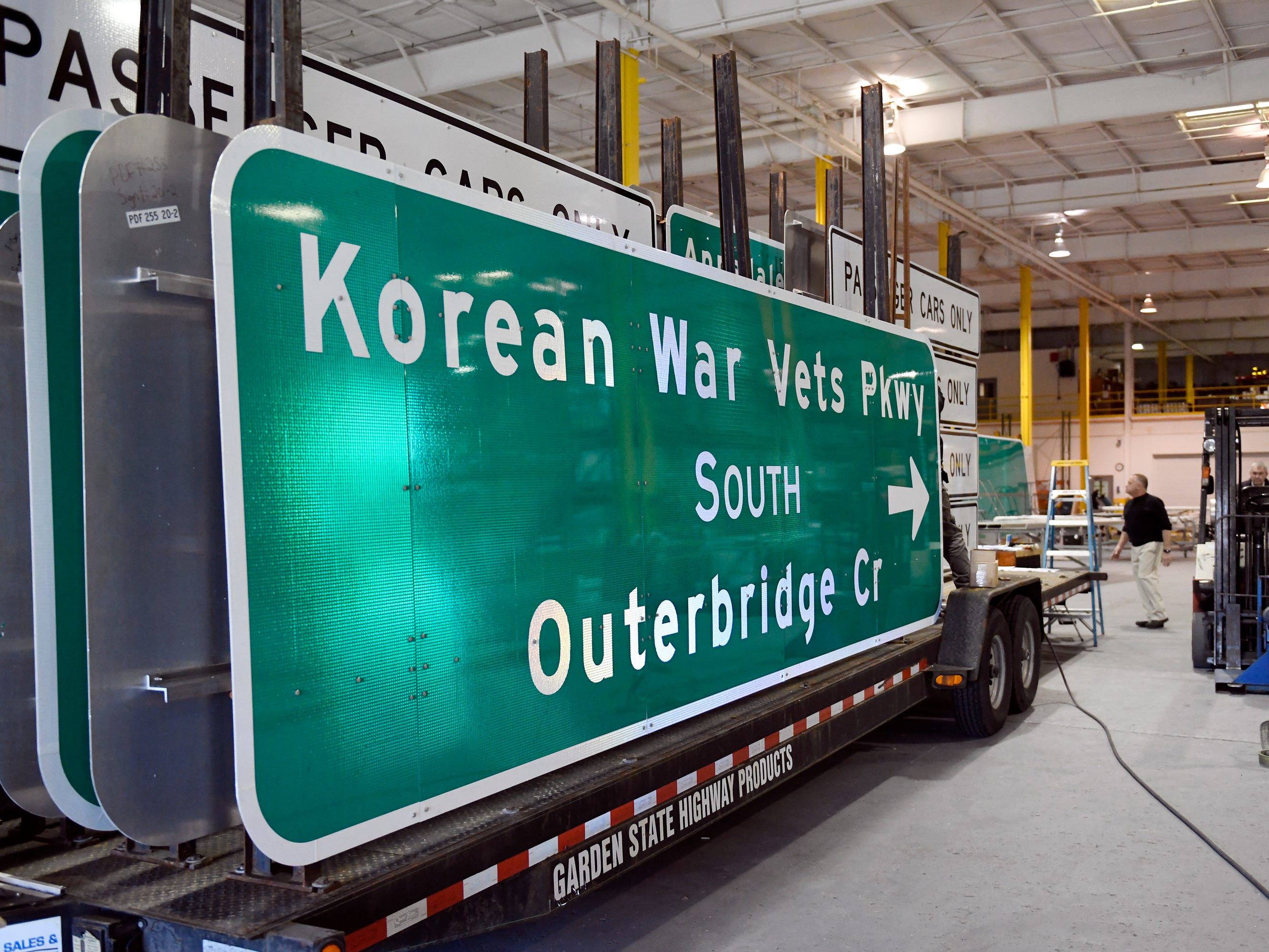 Highway signs created at Garden State Highway Products, Inc. are mounted on a trailer and prepped for delivery inside the 140,000 square foot facility in Millville on Tuesday, Mar. 12, 2019.