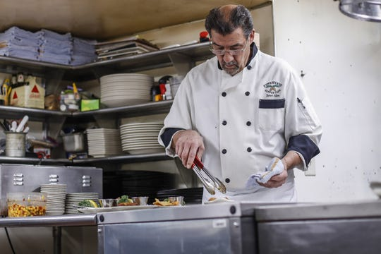 Owner and head cook Steve Allen prepares some dishes at Pinewood Supper Club in Mosinee.