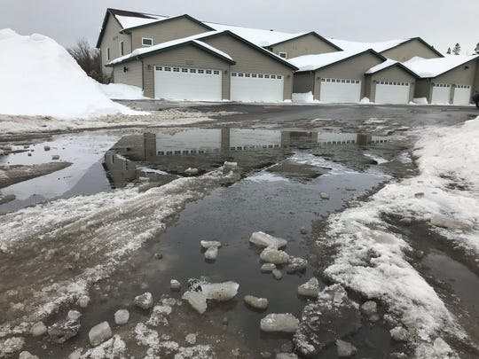 High temperatures and rain left big puddles on South 50th Avenue in Wausau Tuesday afternoon.