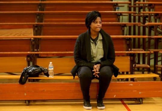Alina Patton Jones sits in the gymnasium at Roosevelt High School in Yonkers on March 13, 2019, a day after a fire destroyed much of the Yonkers apartment building that she lives in with her husband, Charlie, and daughters Taylor and London.