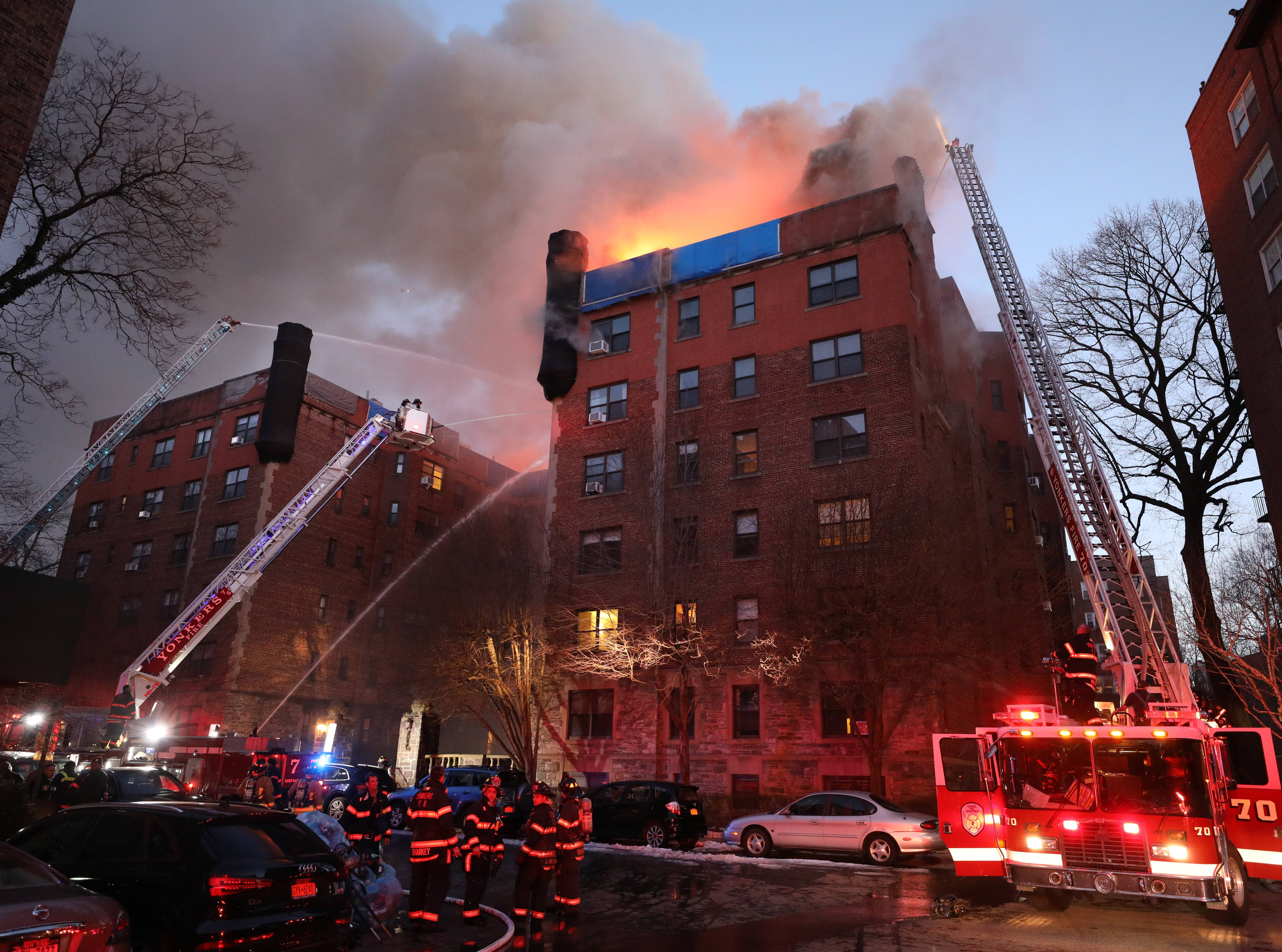 Flames leap from the roof as Yonkers firefighters battle a four alarm fire at 15 Parkview Avenue in Yonkers, March 12, 2019.
