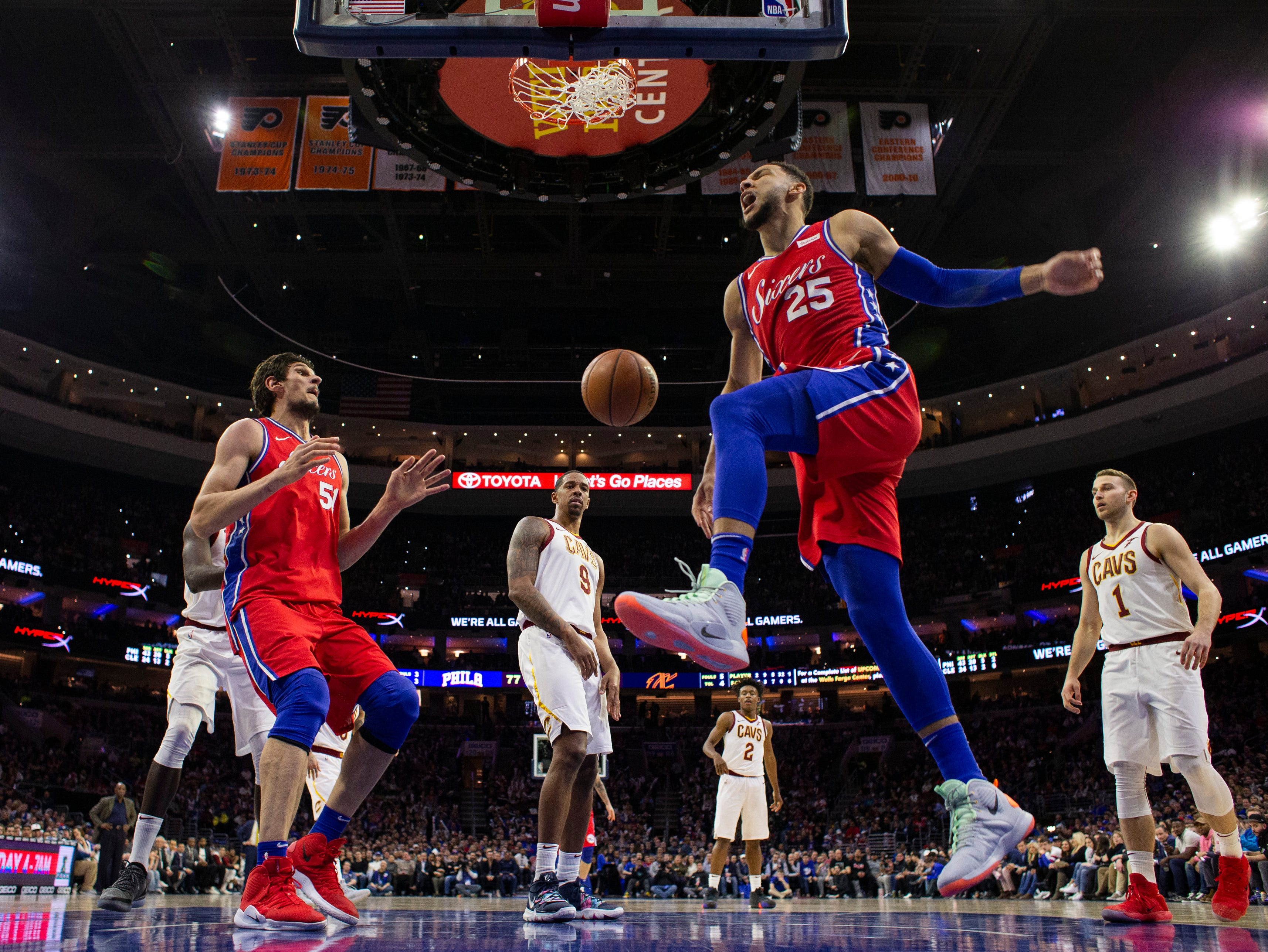 Philadelphia 76ers' Ben Simmons, right, of Australia, reacts to his dunk during the second half of an NBA basketball game against the Cleveland Cavaliers, Tuesday, March 12, 2019, in Philadelphia. The 76ers won 106-99. (AP Photo/Chris Szagola)