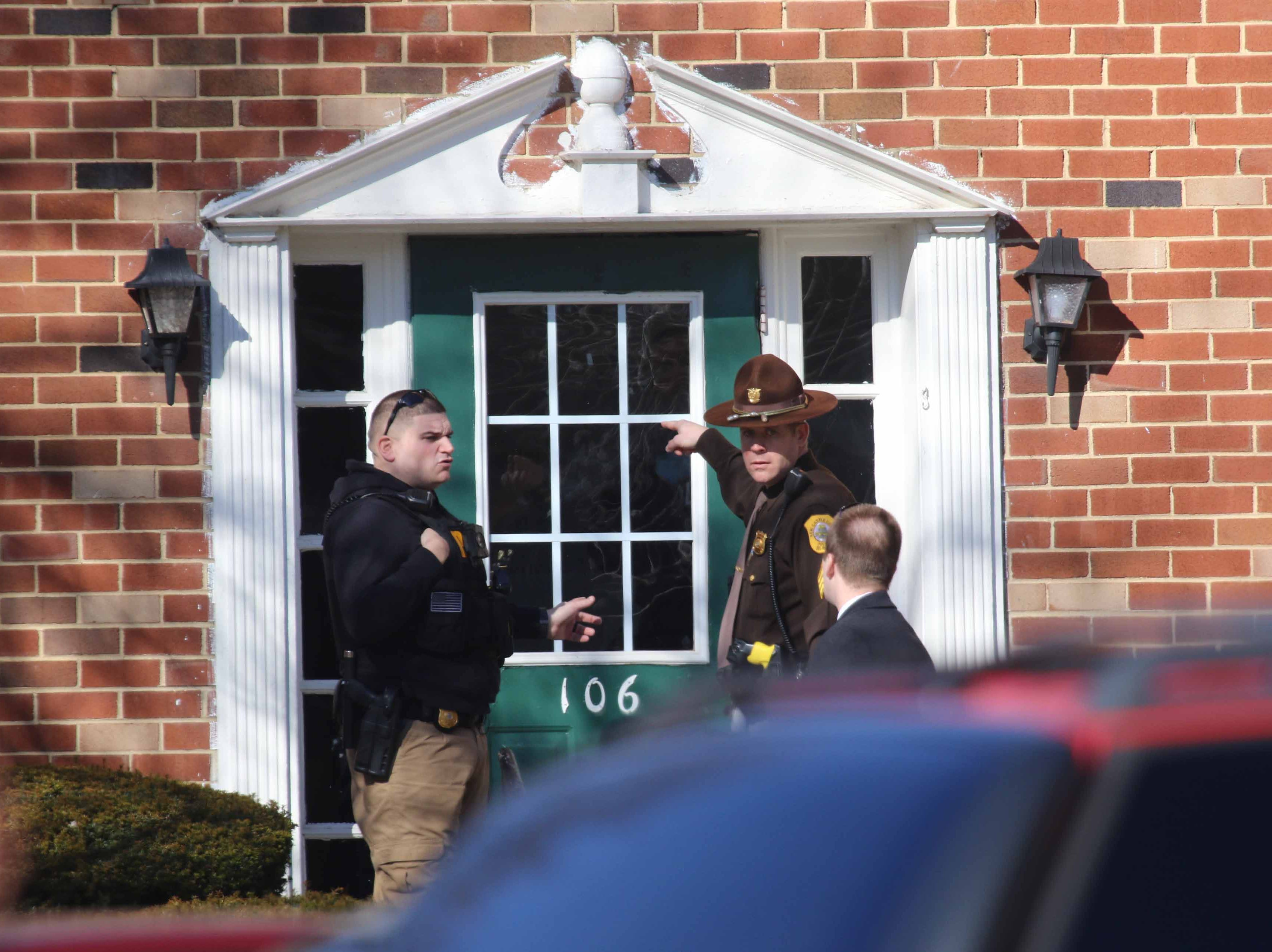 Police investigate an apartment on 100 block of Richards Drive in Newport Wednesday morning after two people were found dead.