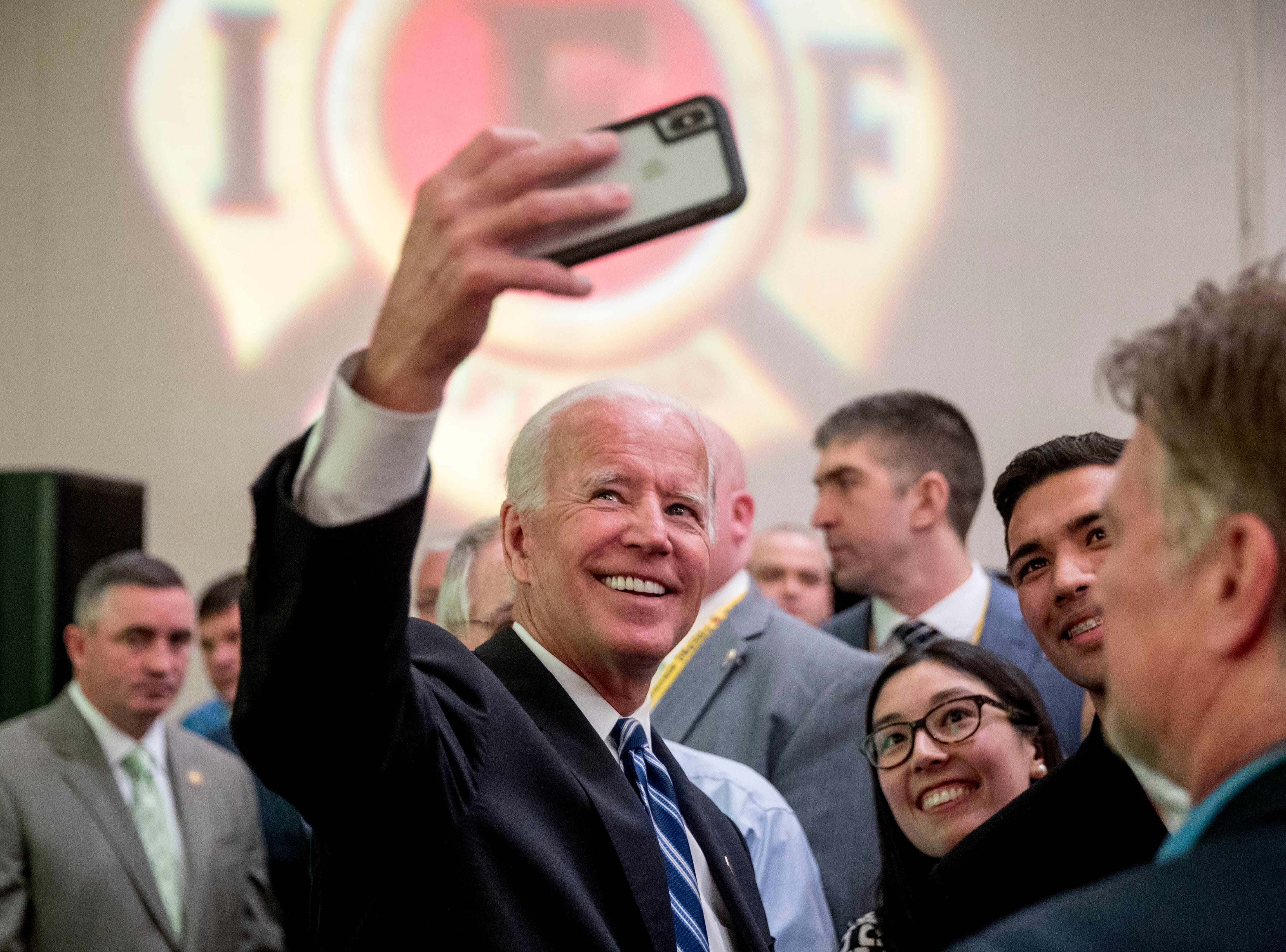 Former Vice President Joe Biden takes a photograph with members of the audience after speaking to the International Association of Firefighters at the Hyatt Regency on Capitol Hill in Washington, Tuesday, March 12, 2019, amid growing expectations he'll soon announce he's running for president.