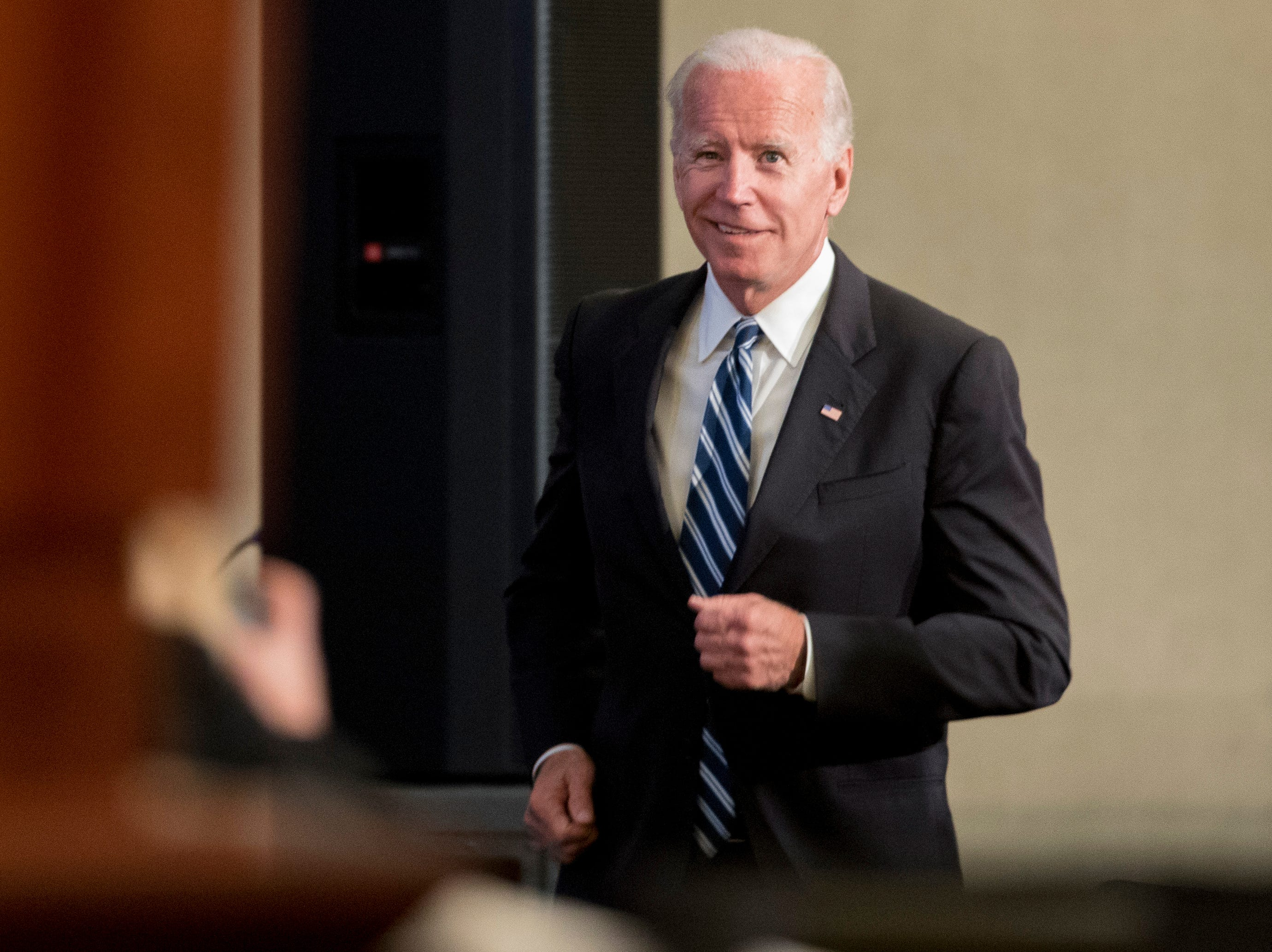 Former Vice President Joe Biden takes the stage to speak to the International Association of Firefighters at the Hyatt Regency on Capitol Hill in Washington, Tuesday, March 12, 2019, amid growing expectations he'll soon announce he's running for president.