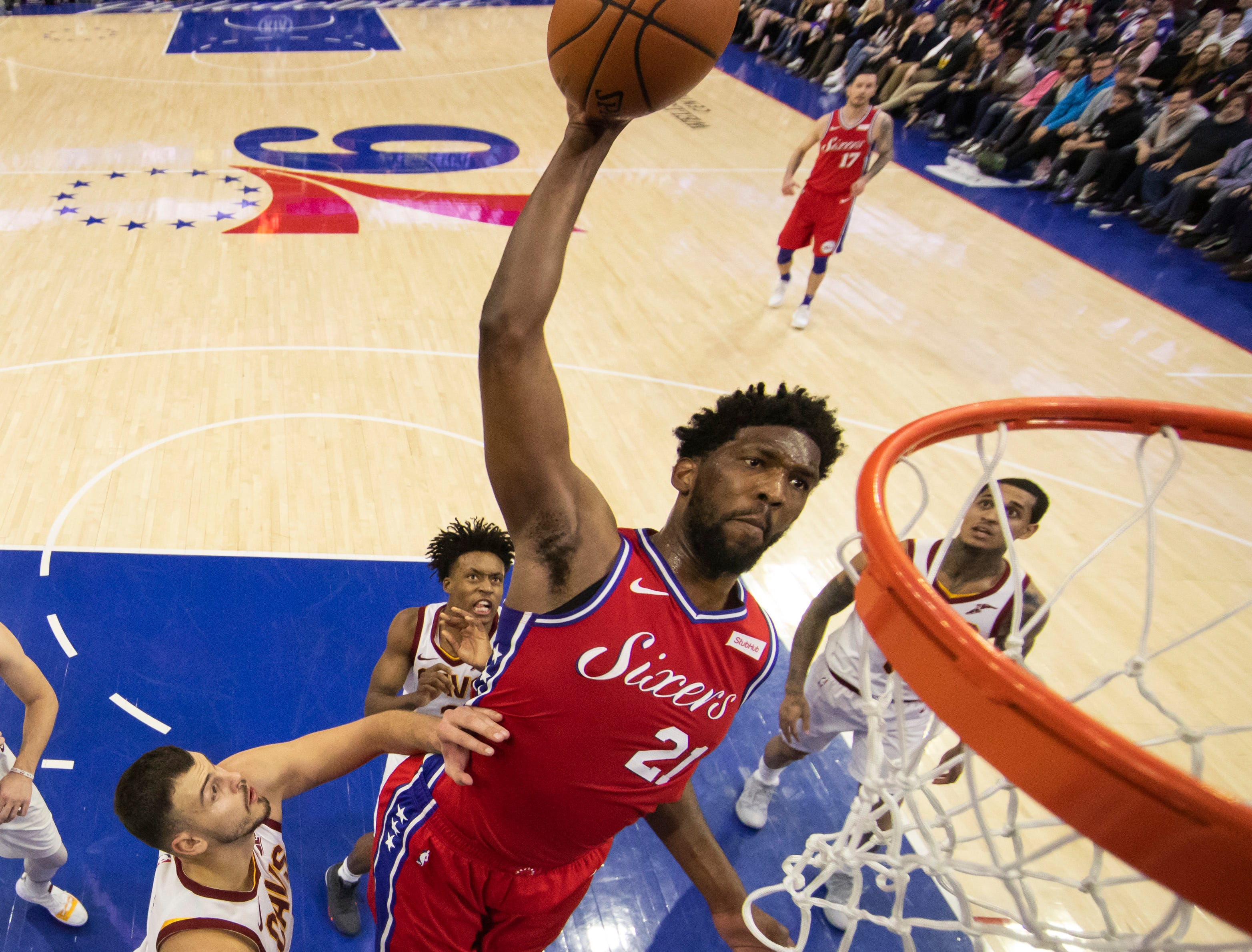 Philadelphia 76ers' Joel Embiid, of Cameroon, dunks against Cleveland Cavaliers' Ante Zizic, left, of Croatia, during the second half of an NBA basketball game, Tuesday, March 12, 2019, in Philadelphia. The 76ers won 106-99. (AP Photo/Chris Szagola)