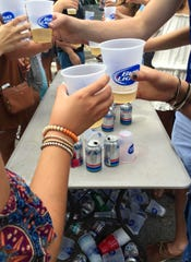 """University of Delaware students drink in mass numbers during dages, or daytime parties. The new law aims to curb what Newark residents call """"super parties."""""""