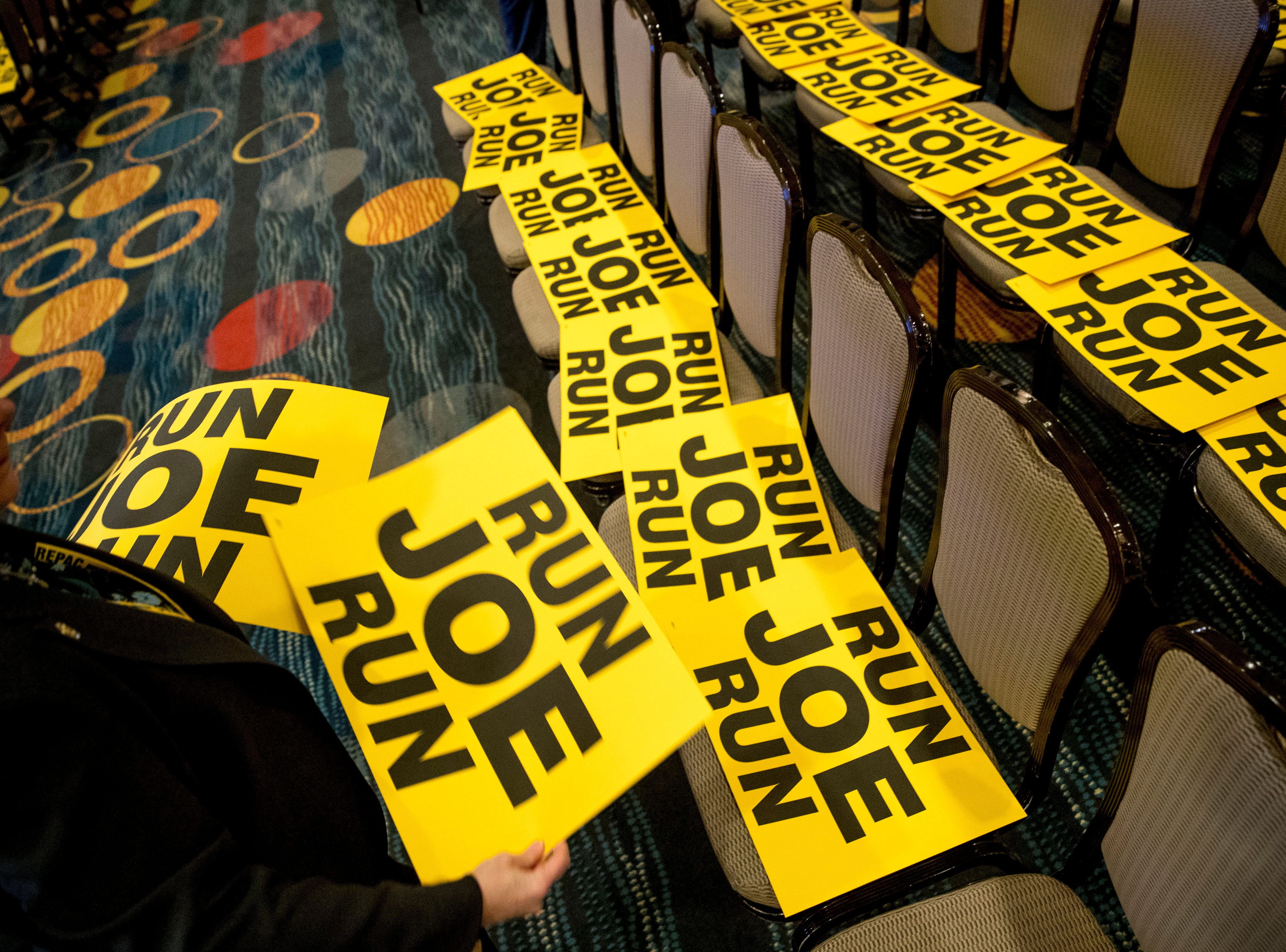 "Workers lay out signs that read ""Run Joe Run"" ahead of a speech by former Vice President Joe Biden to the International Association of Firefighters at the Hyatt Regency on Capitol Hill in Washington, Tuesday, March 12, 2019."