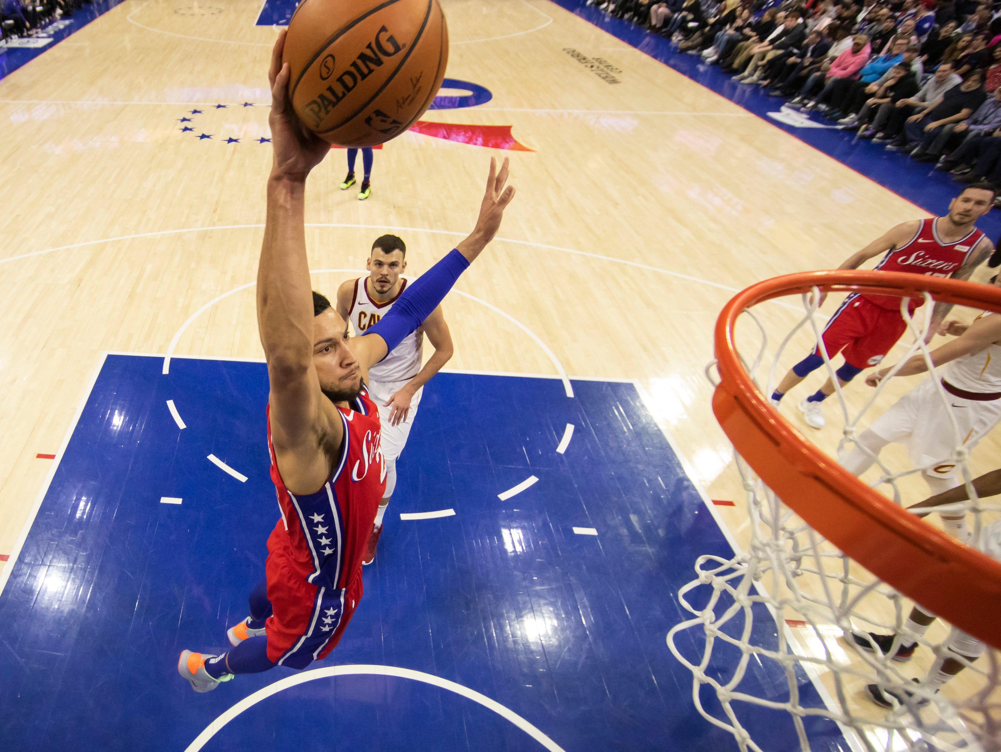 Philadelphia 76ers' Ben Simmons, of Australia, dunks during the second half of an NBA basketball game against the Cleveland Cavaliers, Tuesday, March 12, 2019, in Philadelphia. The 76ers won 106-99. (AP Photo/Chris Szagola)