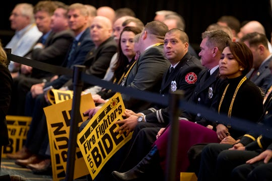 Firefighters in the audience wait for former Vice President Joe Biden to speak to the International Association of Firefighters at the Hyatt Regency on Capitol Hill in Washington, Tuesday, March 12, 2019, amid growing expectations he'll soon announce he's running for president.