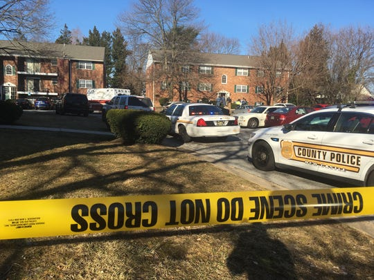 Police respond to Stonehurst Garden Apartments outside Newport, where a woman and her son were found dead.