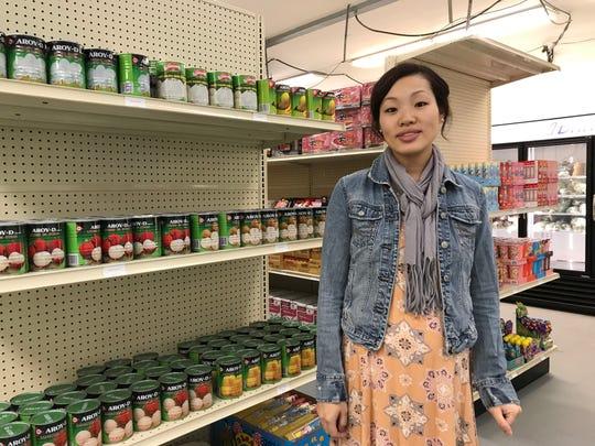 Yer Yang owns Loyal-Phant Market with her husband, Vang Lor.