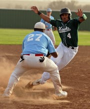 Patrick Johnston/Times Record News Iowa Park's Lee Clubb (4) tries to get past a tag out by Hirschi's Joe Barron (27) on a fielder's choice play to end the second inning March 23, 2011.