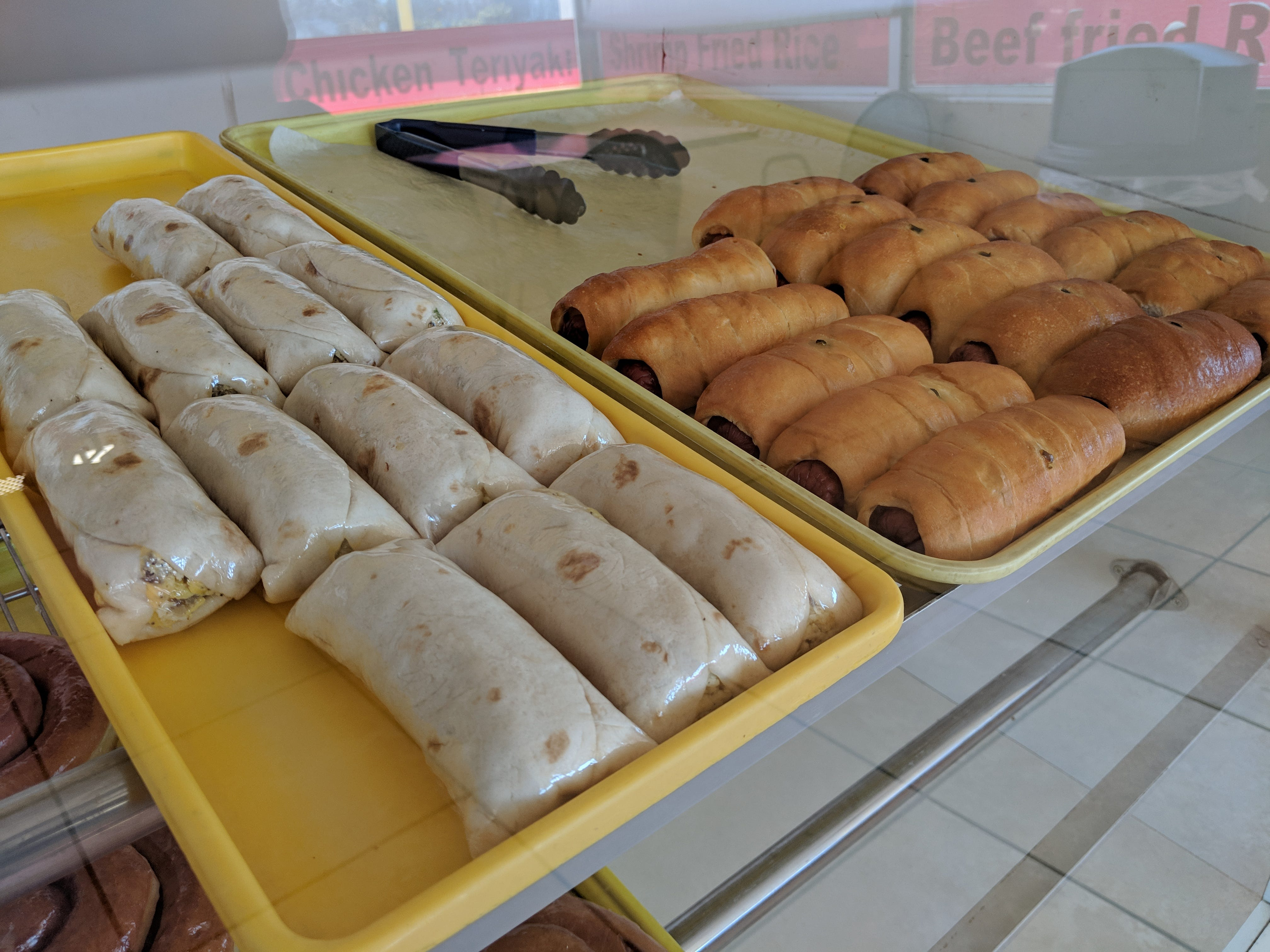 Burritos and wrapped hotdogs at Tommy's Donut.