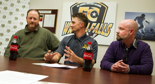 Wichita Falls Parks and Recreation Athletic Coordinator Travis Pence, left, talks with FC Wichita Falls Head Coach  Brandon Swartzendruber and Wichita Falls MPEC General Manager Michael Tipton, right, after announcing a youth soccer league Wednesday afternoon.