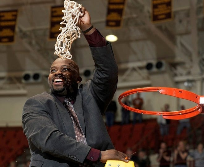 Midwestern State's Nelson Haggerty celebrated the Mustangs' regional title in 2011-12.