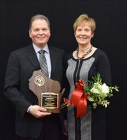 Mark and Valerie Holschbach of Baraboo are this year's Distinguished Holstein Breeders.