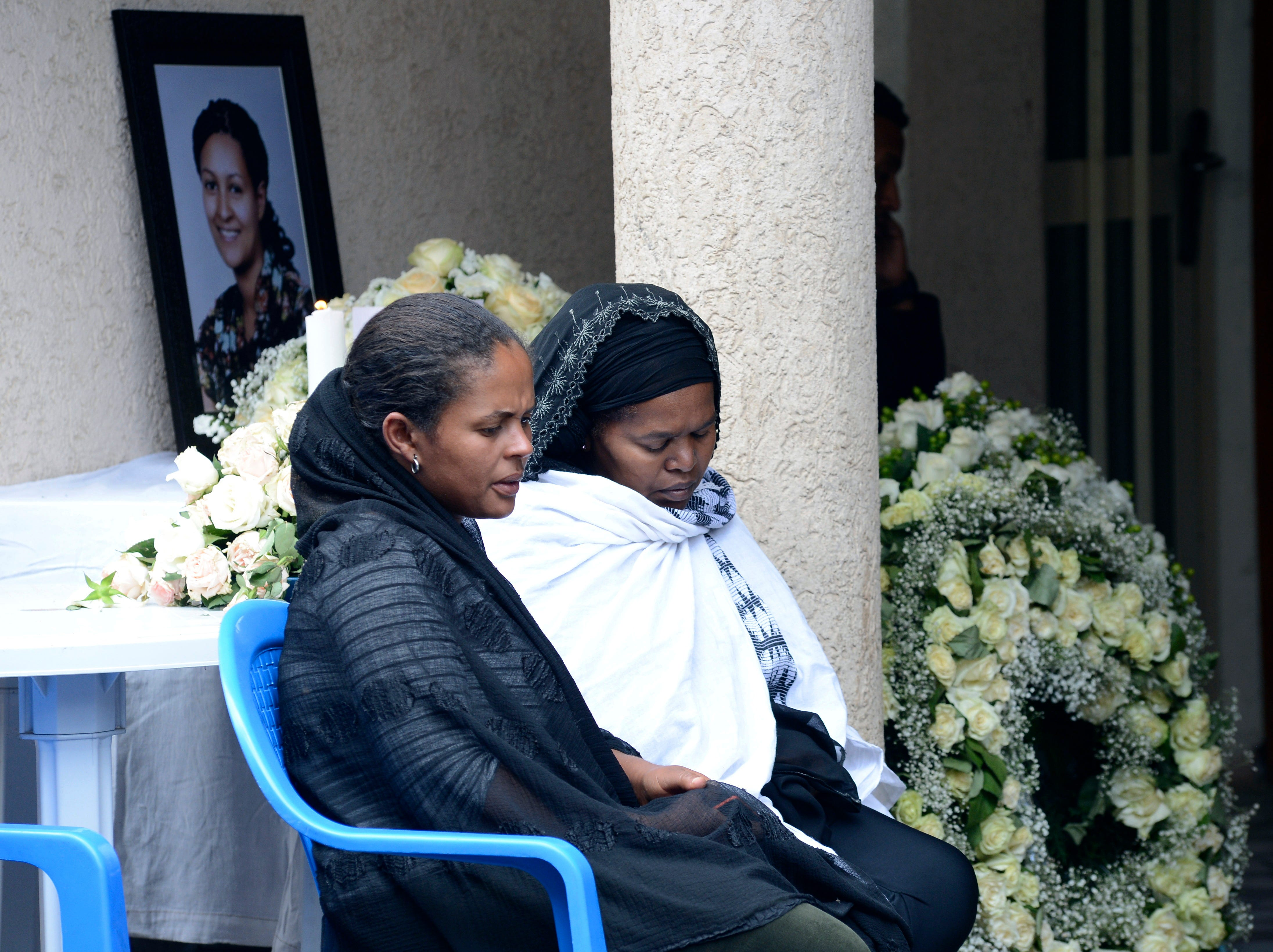 Family members mourn for crash victim air hostess Sara Gebremichael, 38, at her house in Addis Ababa, Ethiopia, Wednesday, March 13, 2019. Ethiopian Airlines Boeing 737 Max 8 crashed shortly after takeoff on Sunday killing all 157 on board, near Bishoftu, south of Addis Ababa, in Ethiopia .The black box from the Boeing jet that crashed will be sent overseas for analysis but no country has been chosen yet, an Ethiopian Airlines spokesman said Wednesday, as much of the world grounded or barred the plane model and grieving families arrived at the disaster site.