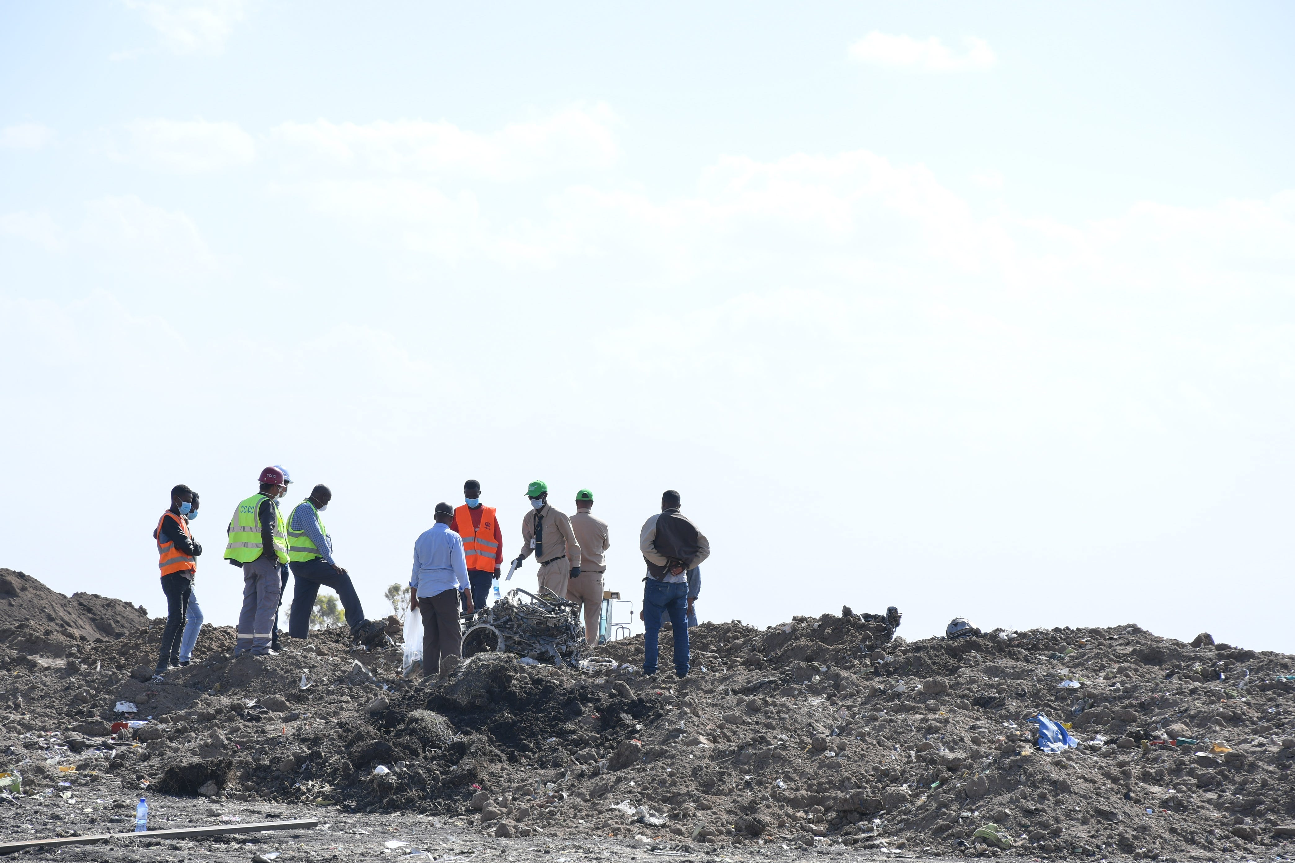 Workers search the site for pieces of the wreckage of an Ethiopia Airlines Boeing 737 Max 8 aircraft near Bishoftu, Ethiopia on March 13, 2019.