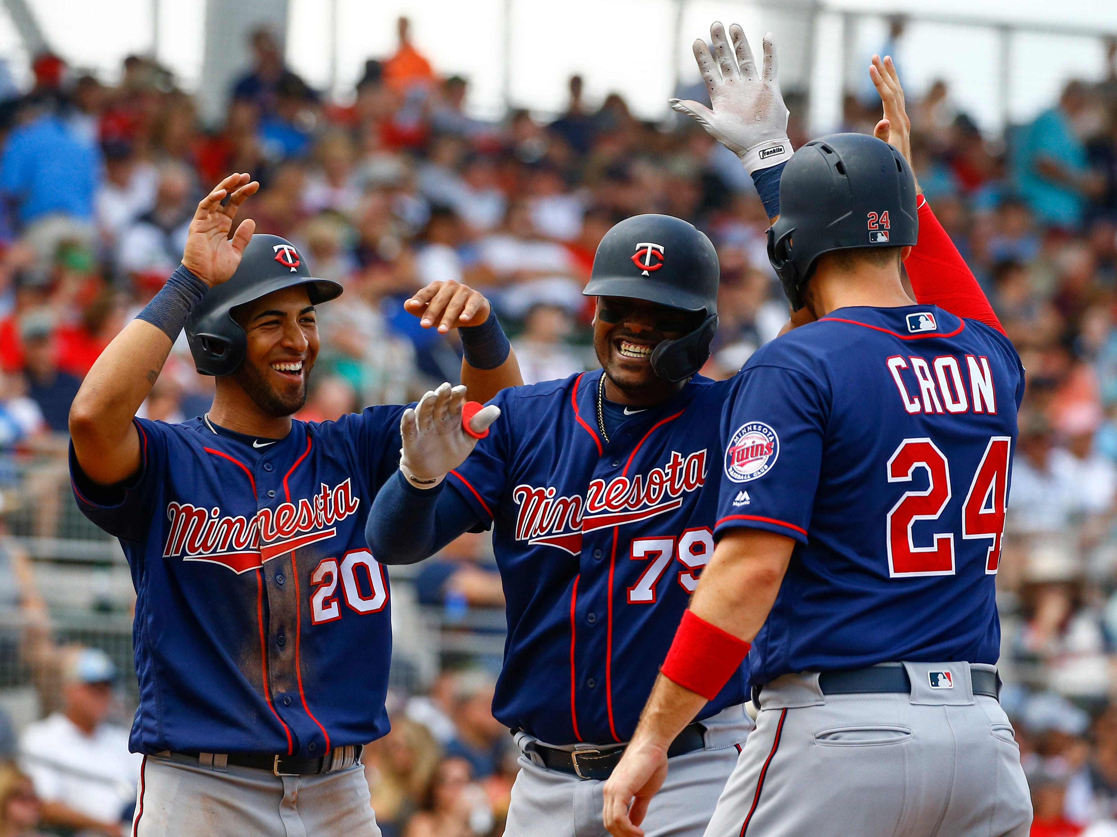 March 13: Twins catcher Brian Navarreto celebrates with teammates after hitting a home run against the Red Sox.
