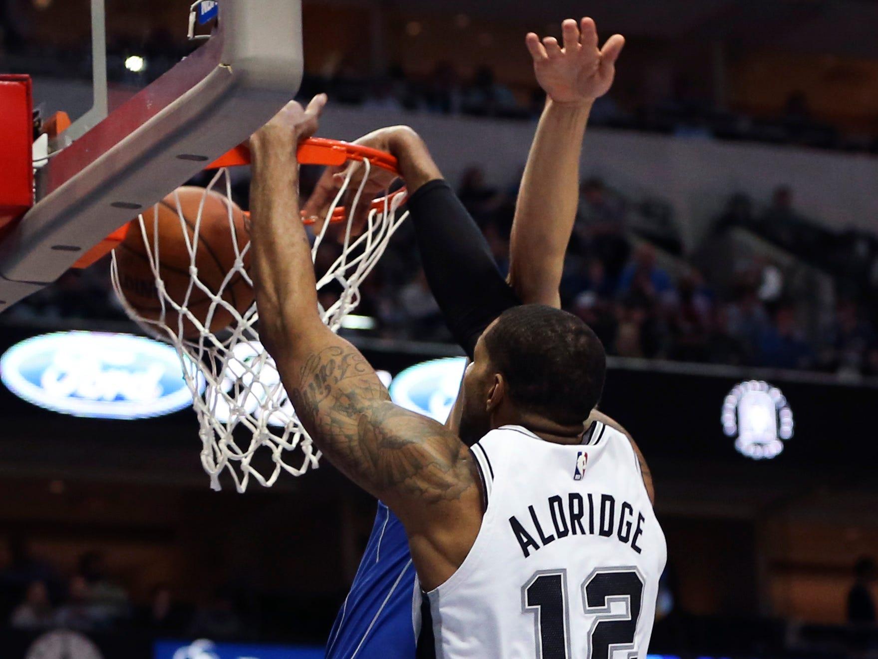 March 12: San Antonio Spurs center LaMarcus Aldridge dunks against the Dallas Mavericks at American Airlines Center.