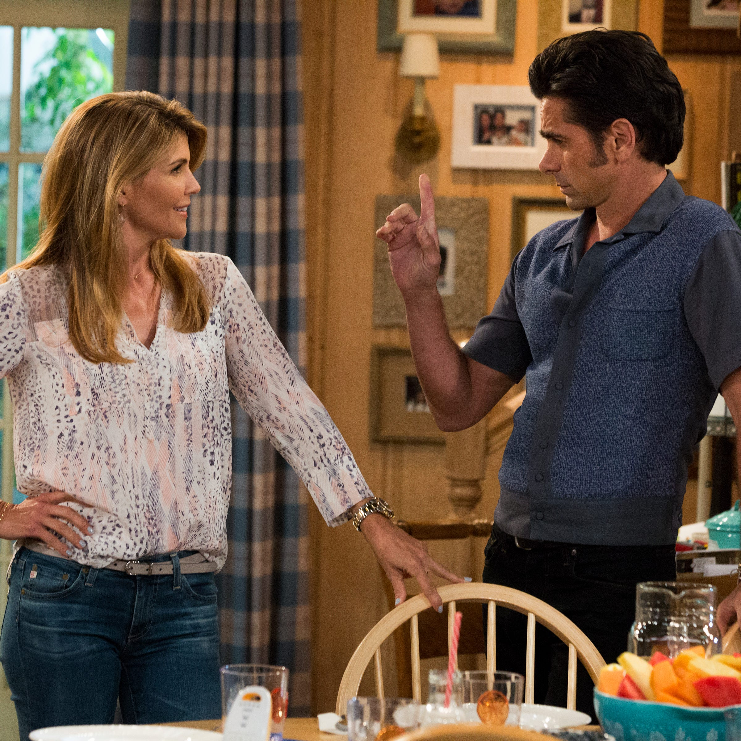 """A scene from Netflix's """"Fuller House"""" with Lori Loughlin and John Stamos."""