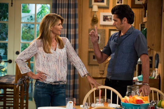 "Lori Loughlin (with John Stamos) reprises her role as Aunt Becky on Netflix's ""Fuller House."""