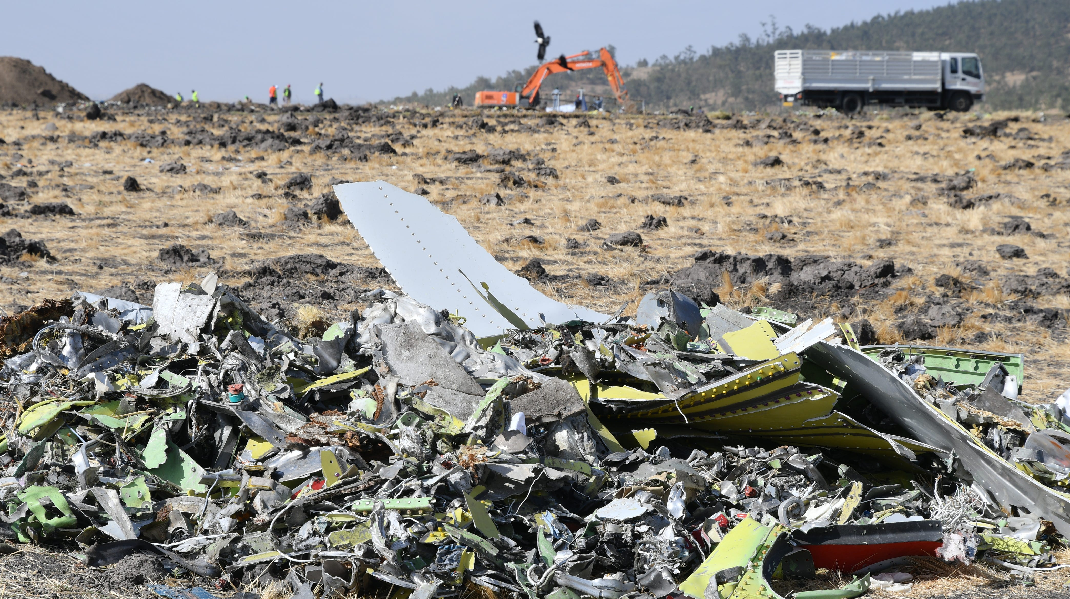 A heap of debris from the wreckage of an Ethiopia Airlines Boeing 737 Max 8 aircraft are piled at the crash site near Bishoftu, Ethiopia on March 13, 2019. Ethiopian Airlines flight ET 302 carrying 149 passengers and 8 crew was en route to Nairobi, Kenya, when it crashed on March 10, 2019 by yet undetermined reason. All passengers and crew aboard died in the crash. The Boeing 737 Max 8 aircraft has come under scrutiny after similar deadly crashes in Ethiopia and Indonesia within a few months. Several countries have banned the plane type from their airspace and many airlines have grounded their 737 Max 8 planes for safety concerns after the Ethiopian Airlines plane crashed minutes after take-off on March 10.