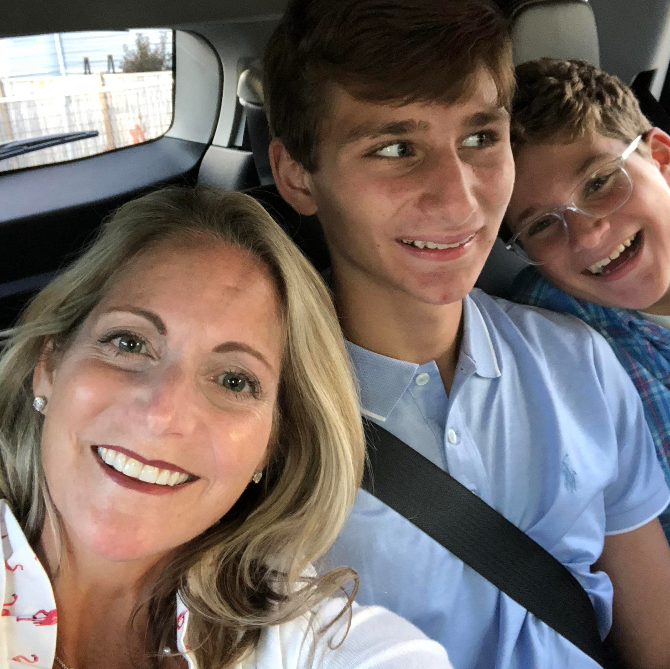 Elise Tedeschi, happy and healthy, clowns with her two sons after surviving stage 4 pancreatic cancer.