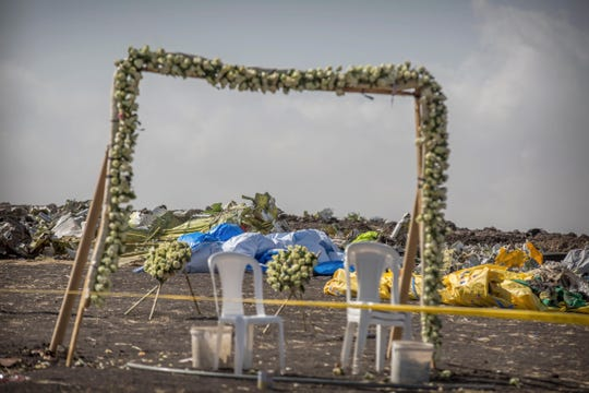 Wreaths and floral installations stand next to piles of wreckage at the scene where the Ethiopian Airlines Boeing 737 Max 8 crashed shortly after takeoff on Sunday killing all 157 on board, near Bishoftu, or Debre Zeit, south of Addis Ababa, in Ethiopia on March 13, 2019.