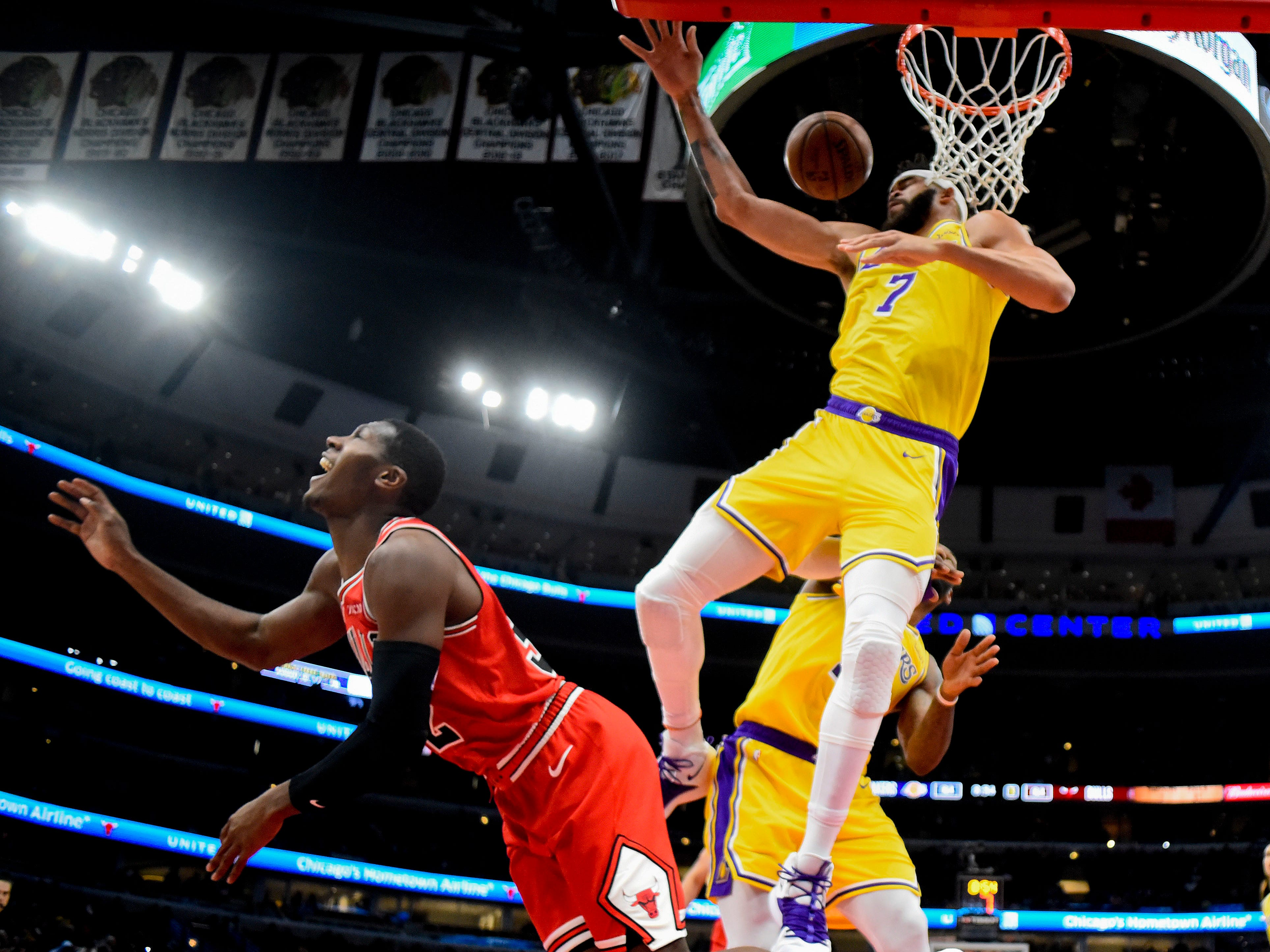 March 12: The Los Angeles Lakers' JaVale McGee and Chicago Bulls' Kris Dunn fight for a rebound in the second half at the United Center. The Lakers won the game, 123-107.