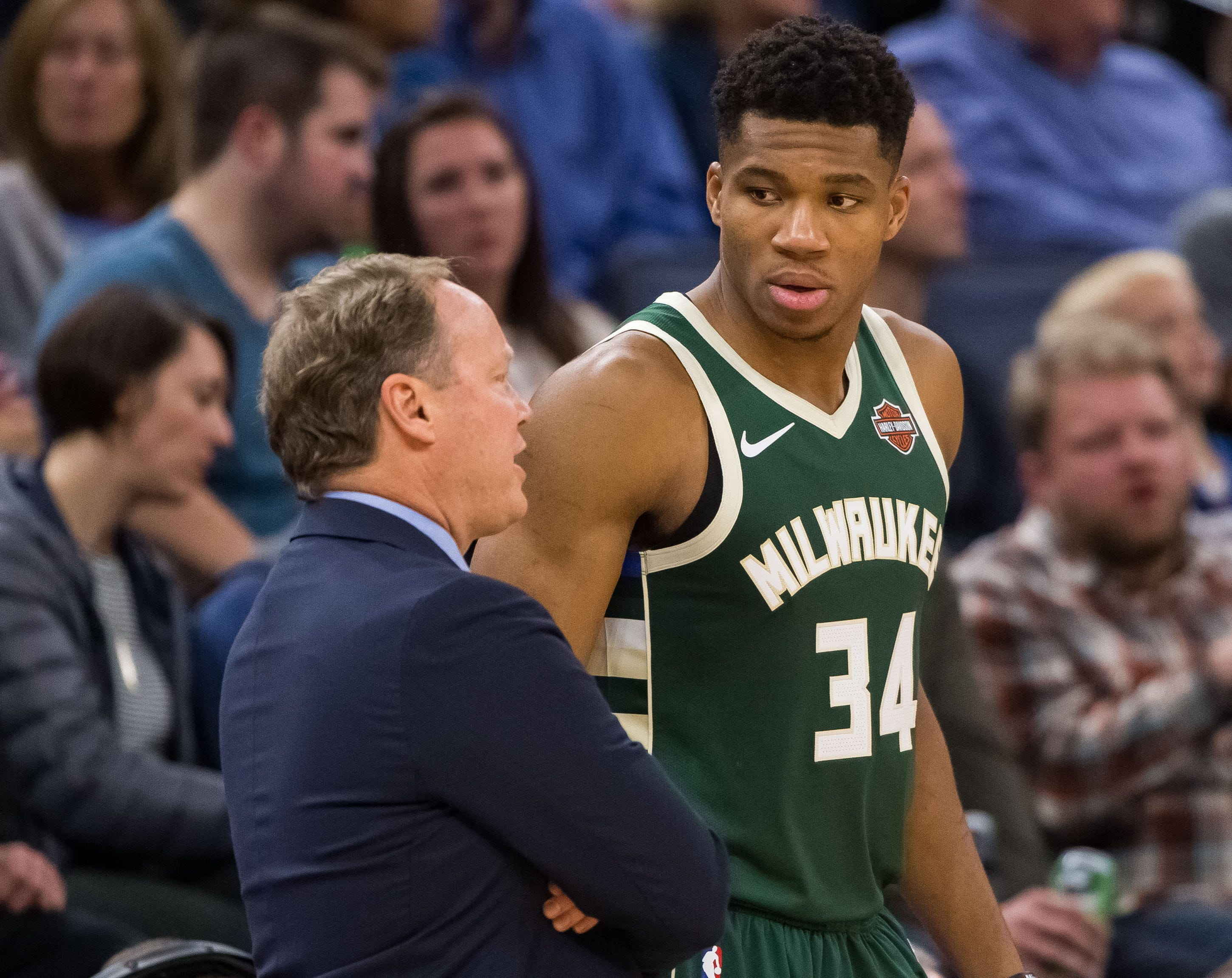 Milwaukee Bucks head coach Mike Budenholzer talks to forward Giannis Antetokounmpo.
