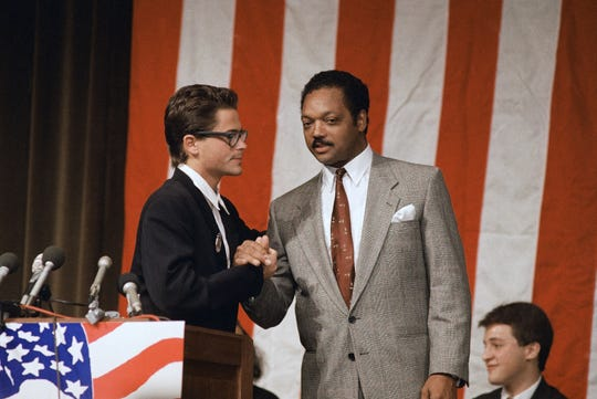 The Rev. Jesse Jackson shakes hands with actor Rob Lowe in Evanston, Illinois, in 1988.