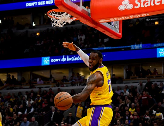 Los Angeles Lakers forward LeBron James dunks during Tuesday's game against the Chicago Bulls.