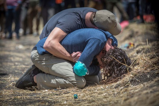 Relatives react at the scene where the Ethiopian Airlines Boeing 737 Max 8 crashed shortly after takeoff on Sunday killing all 157 on board, near Bishoftu, south of Addis Ababa, in Ethiopia Wednesday, March 13, 2019.