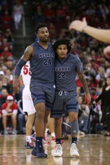 Guard Jordan Caroline (24) and guard Jazz Johnson (22) are two of the transfers who have carried Nevada into the polls all season.