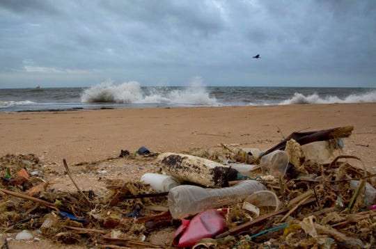 In a file photo, debris is seen washed ashore on a beach in Sri Lanka.