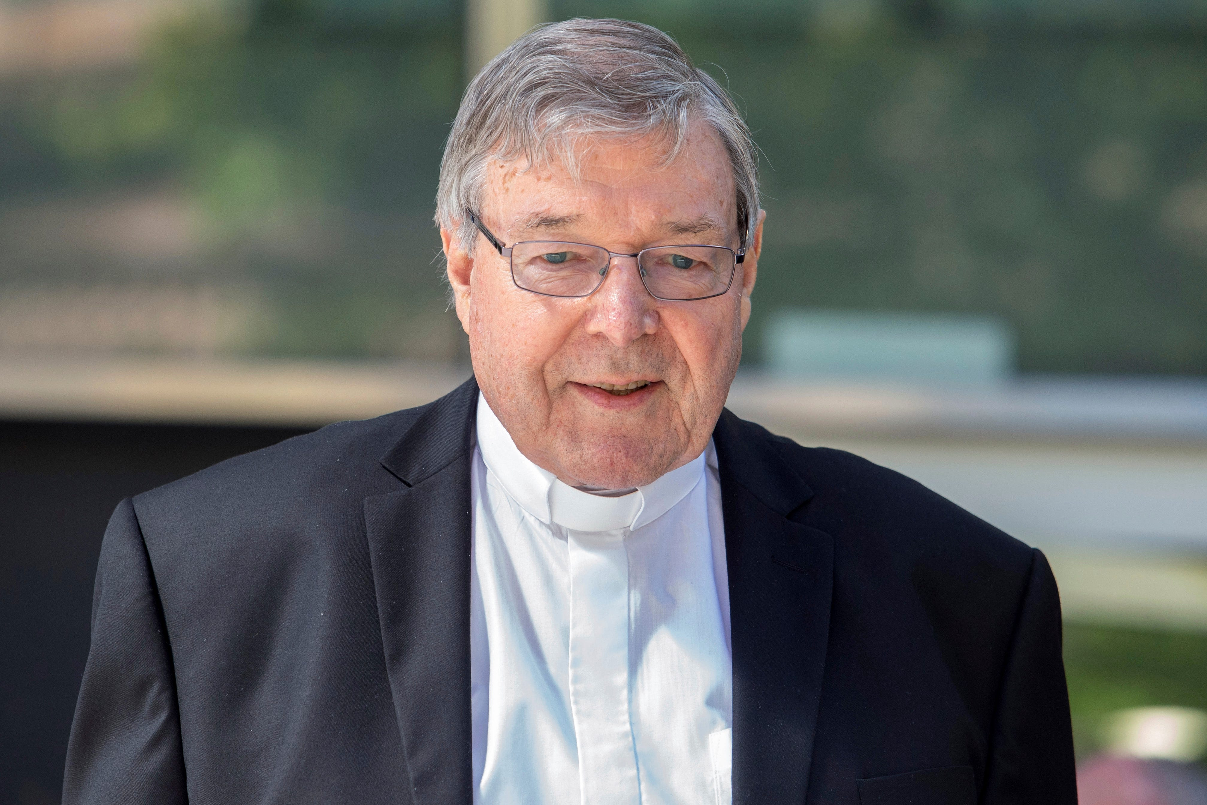Cardinal George Pell, the most senior Catholic cleric to face sex charges, departs an Australian court.