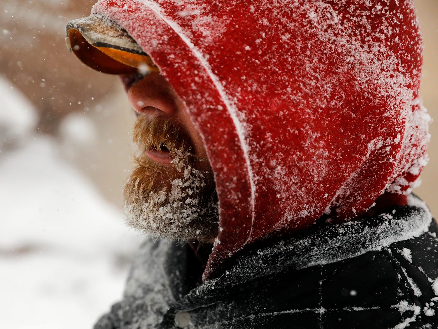 Joe Miller's beard freezes over as he walks through downtown Casper, Wyo., during a winter storm March 13, 2019. The storm brought blizzard conditions to parts of Colorado, Wyoming, Montana, Nebraska and South Dakota.