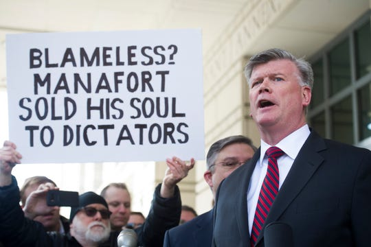 A protester and Paul Manafort's defense attorney Kevin Downing, in Washington, D.C. on March 13, 2019.