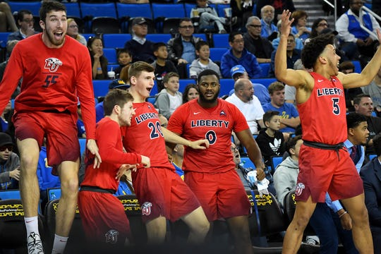Liberty players celebrate during the second half of their game at UCLA in 2018.