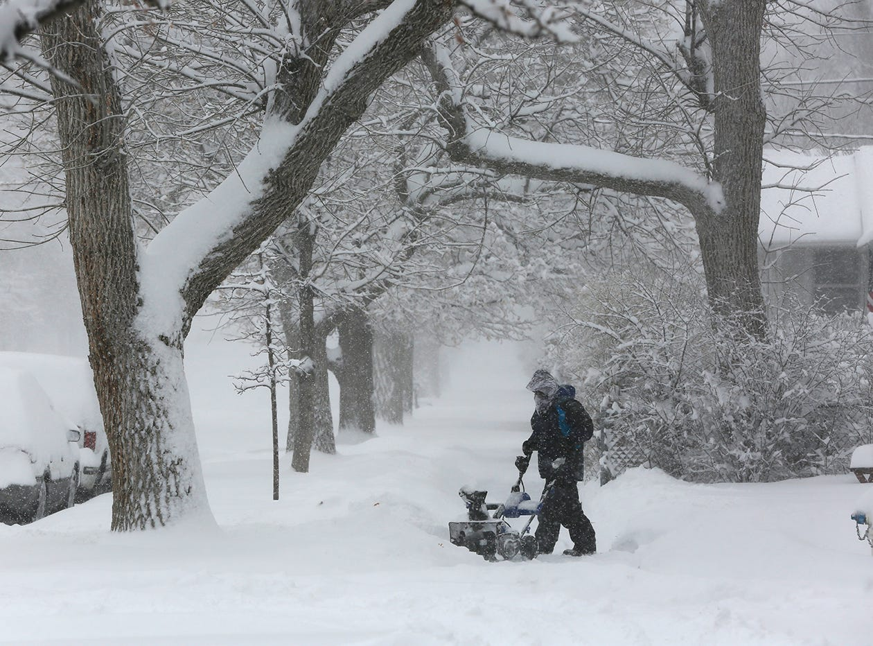 A person works on clearing snow during a winter storm March 13, 2019 in Casper, Wyo. The storm brought blizzard conditions to parts of Colorado, Wyoming, Montana, Nebraska and South Dakota.